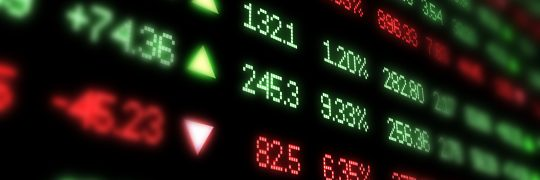 Stock market ticker board blurred at edges